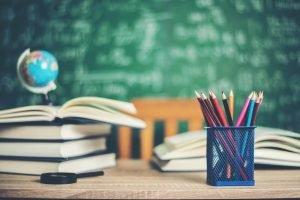 Classroom chalkboard with university books